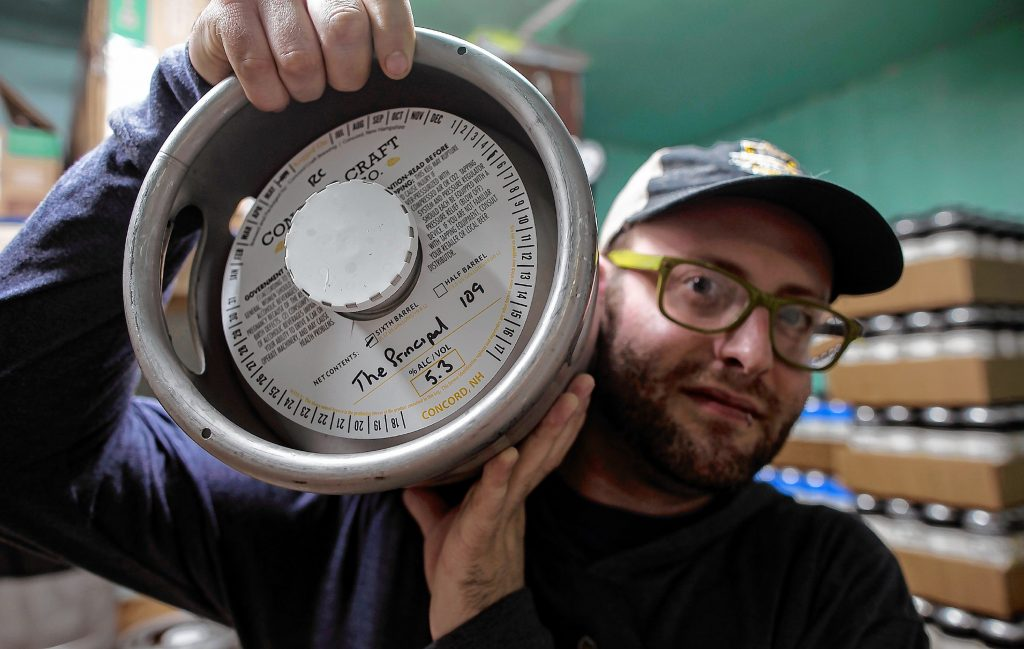 "Noah Brochu, tasting room manager for Concord Craft brewing holds a mini-keg of the new pale ale, ""The Principal,"" in Connolly's honor this month to raise money for the  ALS Therapy Development Institute."