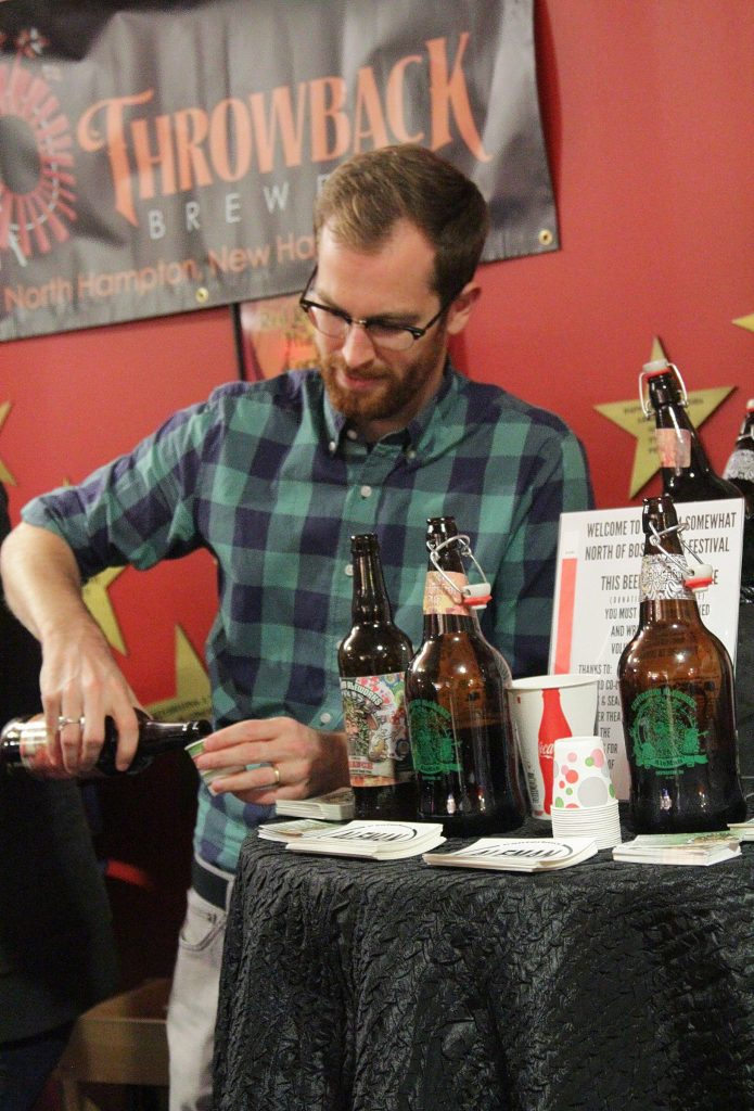 Aiden Redmon of Canterbury Aleworks pours a sample in the lobby of Red River Theatres on Thursday, Nov. 6, 2014. The Concord Co-op hosted a beer tasting and food event to kick off the SNOB Film Festival on Thursday evening. (Breaking news: it was yummy.) This page, top left: Glasses and mugs with the SNOB logo emblazoned on them. That must be where we got the template for the new tattoo we have but don't remember getting this weekend. Top right: Aiden Redmon of Canterbury Aleworks pours a sample. For his homies. Facing page, top: Jim Tyrrell, self-described singer, songwriter and hooligan, performed for the crowd. Middle: Throwback Brewery was represented by Christopher Naro, assistant brewer. Bottom: It may have been raining beer inside, but it was raining actual rain outside.
