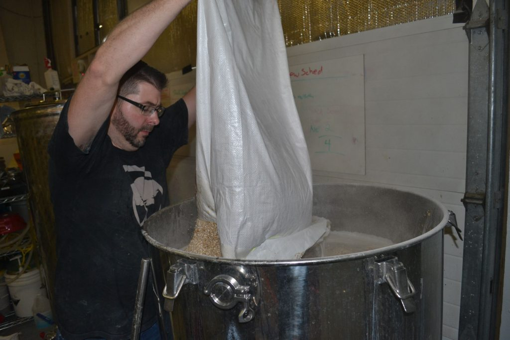 Lithermans co-owner and head brewer Steve Bradbury adds ingredients to a batch of Misguided Angel. TIM GOODWIN / Insider staff