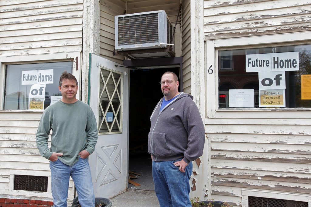 Mark Ferguson (left) and Bill Walden stand in front of the future home of Oddball Brewing Co., at 6 Glass St., Pembroke on Saturday, Oct. 18, 2014.  (SUSAN DOUCET / Monitor staff) Mark Ferguson (left) and Bill Walden stand in front of the future home of Oddball Brewing Co. on Saturday.