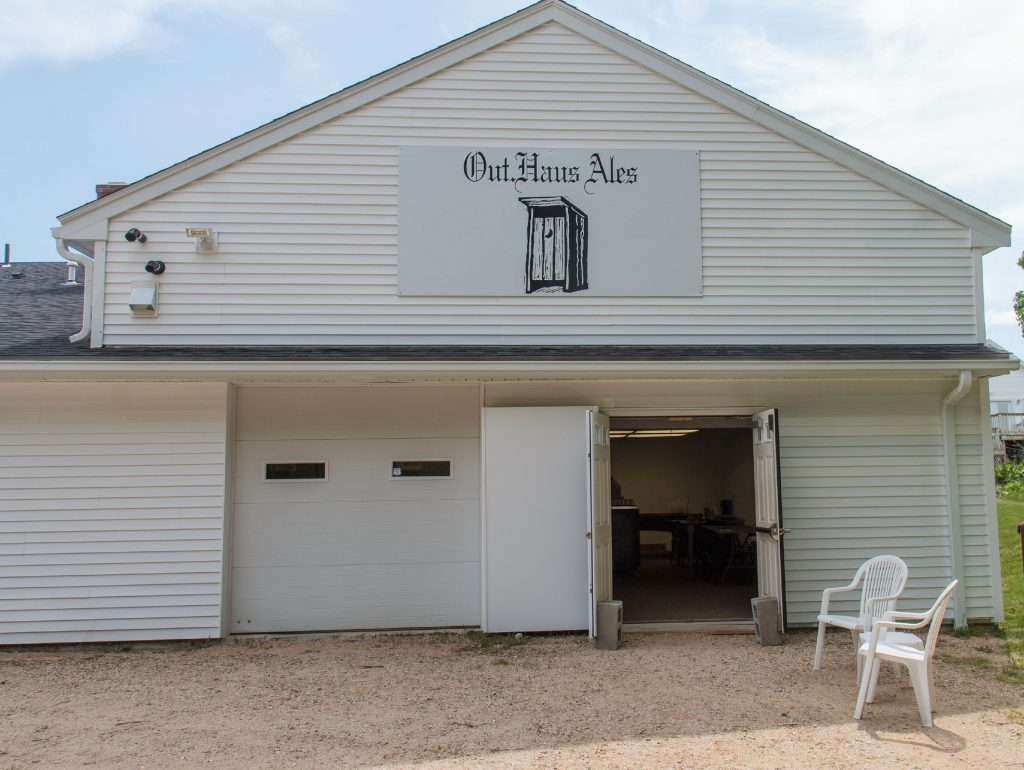 The main entrance to Out Haus Ales located at 442 1st Tpke, Ste 2 in Northwood, NH