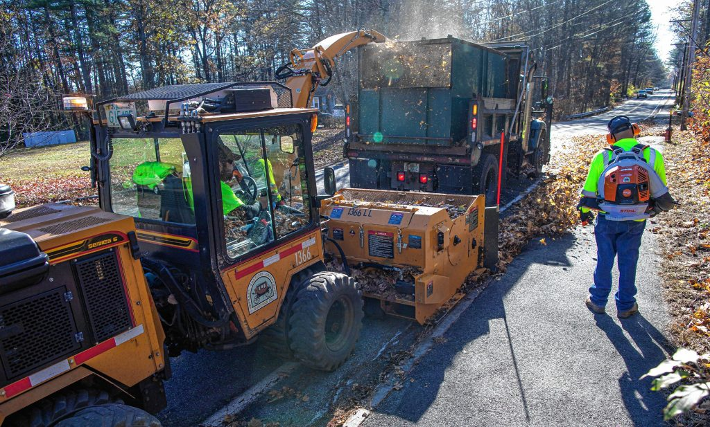 The new leaf collection system moves up Sewell Falls Road in Concord on Thursday, November 5, 2020. GEOFF FORESTER