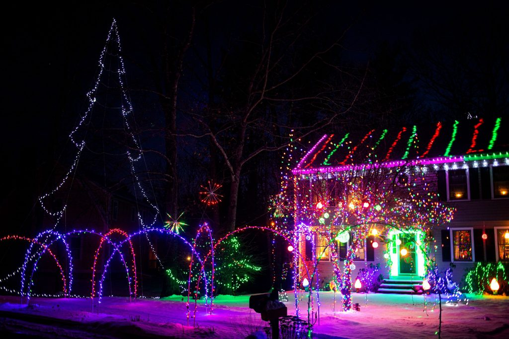 A house on Peterson Circle in Concord is completely lit up on Friday night, December 21, 2019. GEOFF FORESTER