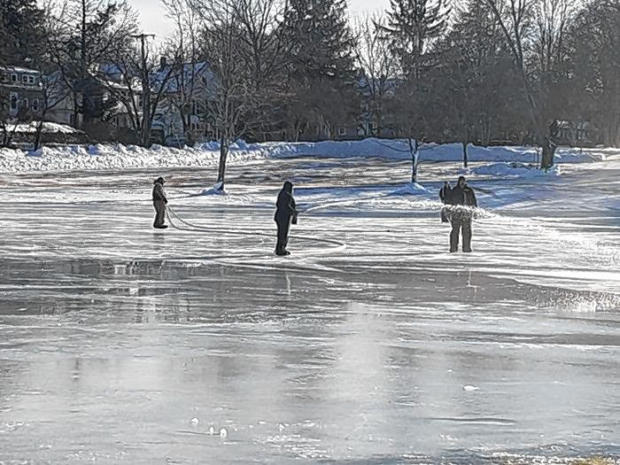 Parks employees work on the ice in January 2020.