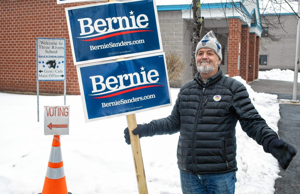 Bernie Fornier holds his Bernie Sanders sign outside the Three Rivers School voting area on Tuesday, February 11, 2020. Geoff Forester