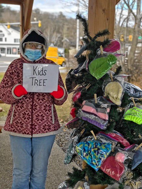 One of the Kindness Trees is a Kids Tree being decorated with knitted items by Natale Smith from the Hooks and Needles Club.