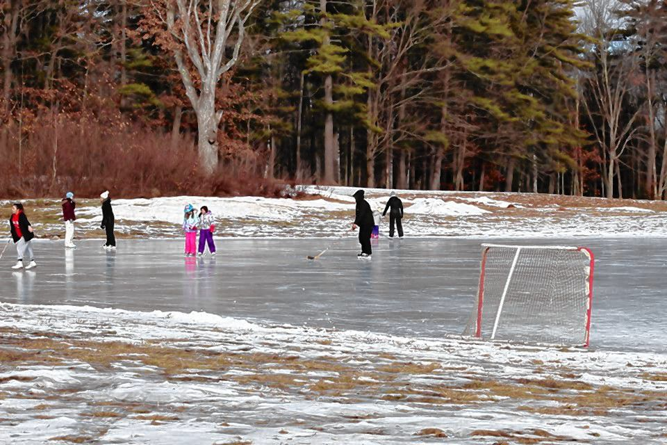 People enjoy skating on the pond at Beaver Meadow Golf Course on Jan. 9, 2021.