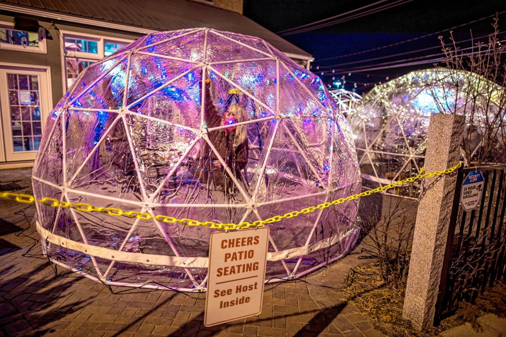 Cheers owner Wendy Roy puts up lights into one of the four igloos she and her co-owner, Todd, are erecting for diners can eat outdoors on the restaurant patio on Monday, January 11, 2020. GEOFF FORESTER