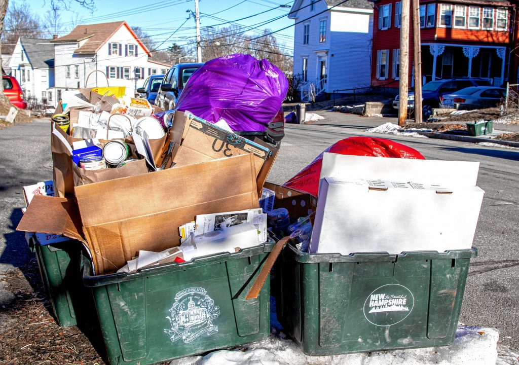 A load of trash and recycling on Rumford Street in Concord on Tuesday, January 26, 2021. GEOFF FORESTER