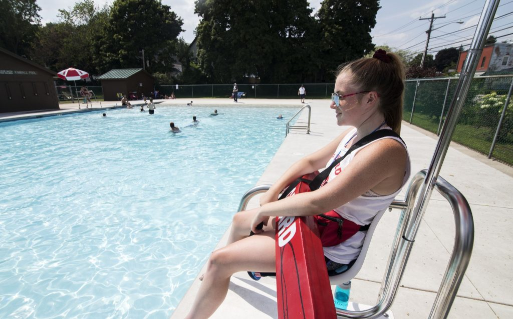 Lifeguard Emily Mitchell keeps watch at Kimball pool on North State Street on Wednesday, July 10, 2019. Kimball has three rotating lifeguards during the day. GEOFF FORESTER