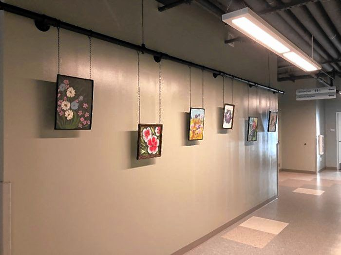 Art hangs on the wall at the gallery space at the City-Wide Community Center.