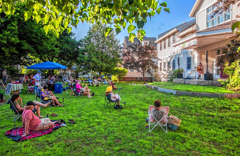 Patrons watch an outdoor concert from the Fletcher-Murphy Park organized by the Bank of N.H. Stage in July. A free concert will be held in the theatre to test protocols.