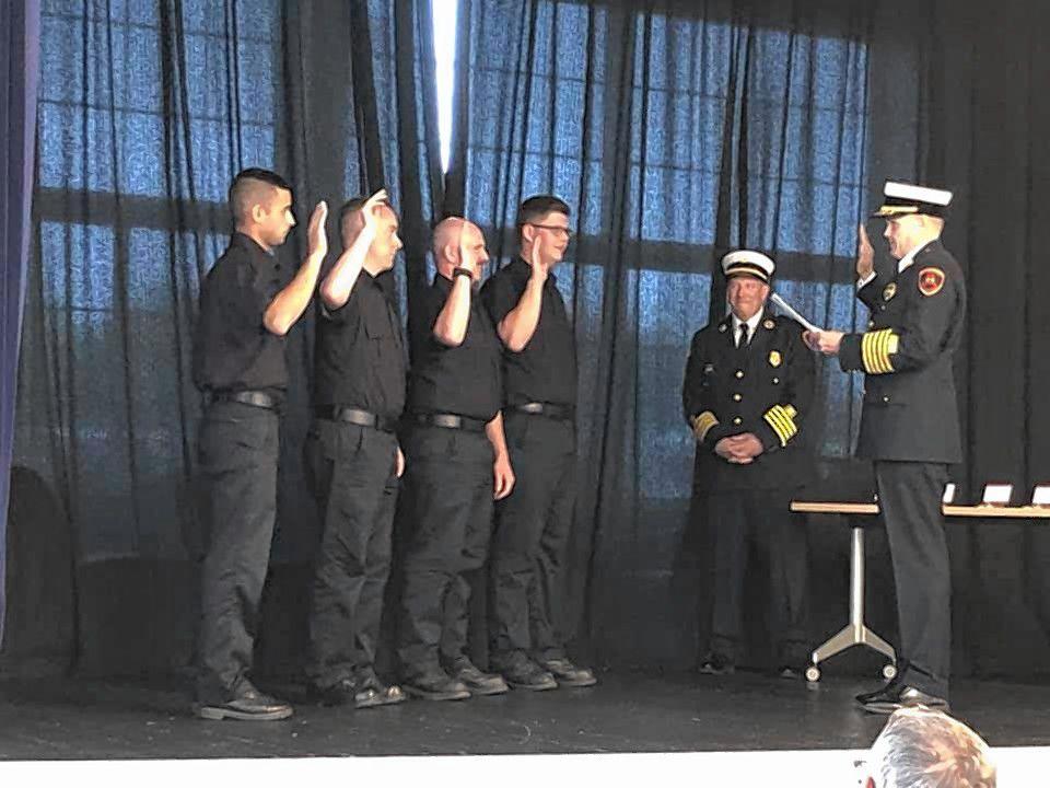 Probationary Firefighter Paramedic Sam Atkins, probationary Firefighter EMT Walter Durack, probationary Firefighter Paramedic Ryan Baron, and probationary Firefighter EMT Tim Wilson are sworn in.